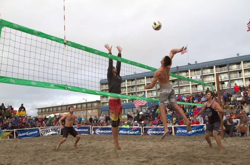 Beach Volleyball Player Spikes the Ball.42 PM