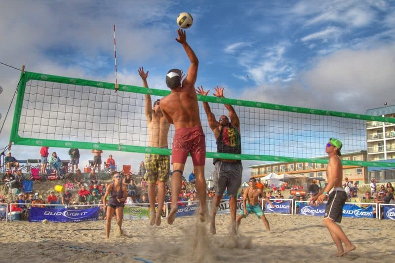 Male Volleyball Player Spiking Ball Seaside OR